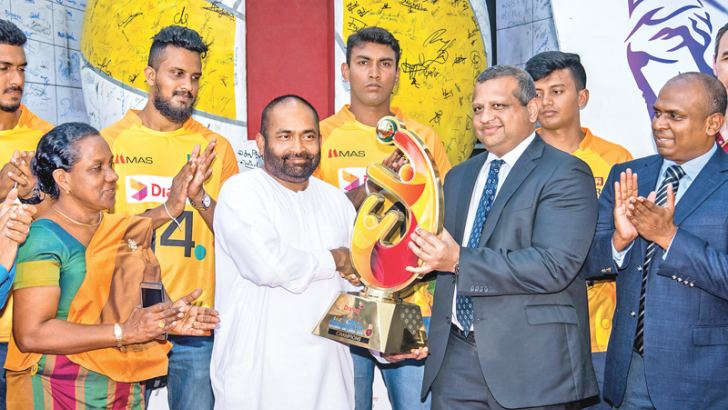 Navin Pieris - Head of Broadband and Fixed Telecommunications, Dialog Axiata PLC officially hands over the Asian Volleyball Championship Trophy to Ranjith Siyamblapitiya MP, Minister of Power and Energy and President National Volleyball Association of Sri Lanka. Also in the picture (L-R), Deputy Director General, Ministry of Sports and Dimuthu Cooray, General Manager - Broadband and Fixed Telecommunication, Dialog Axiata PLC.
