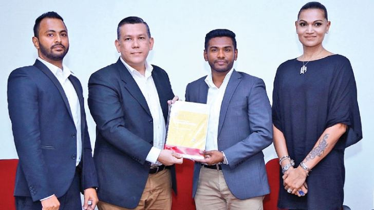 Raffles College of Design and Business College Director Johannes Silaban hands over the new business program curricular to Business Program Coordinator Sajith Gaffoor. Raffles College of Design and Business Marketing Manager Nimesh Palihawadana, Academic Lead and Fashion Design Program Coordinator Dinesh Chandrasena is in picture.