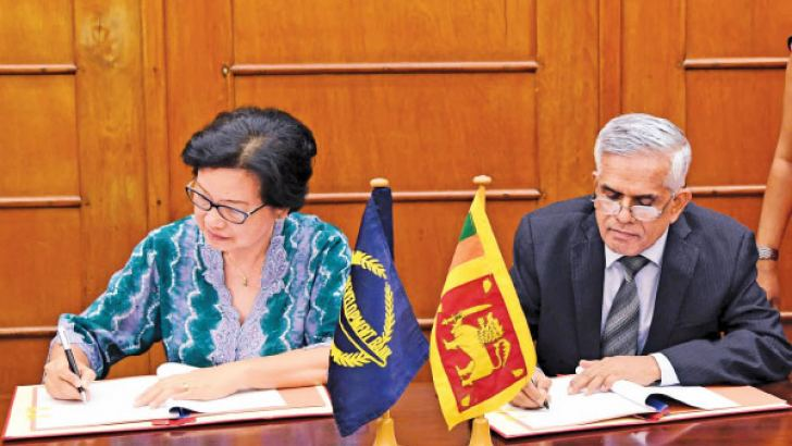 Dr. R H S Samaratunga, Secretary, Ministry of Finance and Mass Media and Sri Widowati, Country Director of ADB Sri Lanka Resident Mission sign the loan agreement  at the Ministry of Finance and Mass Media.
