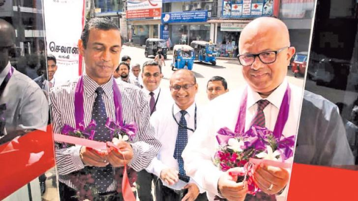 Seylan Bank Deputy General Manager Operations Malik Wickremanayake opens the ATM  in Ragama.