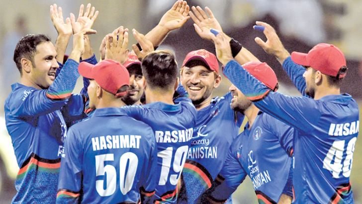 Afghanistan players celebrate the wicket of Sri Lanka captain Angelo Mathews in the Asia Cup match played at Abu Dhabi on Monday. AFP