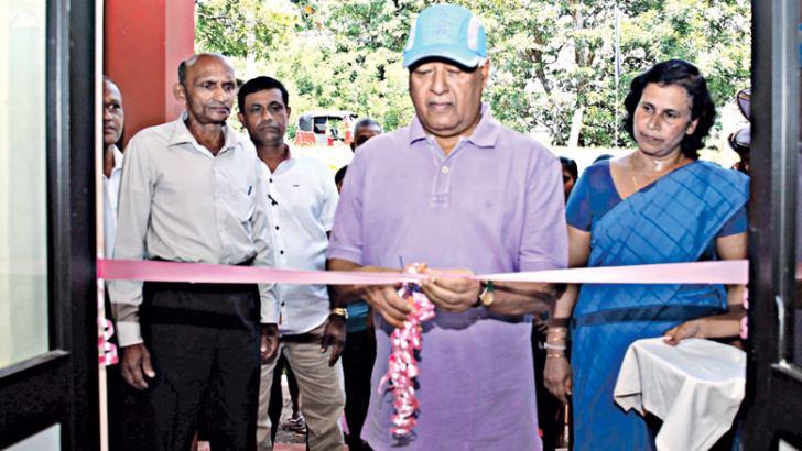 Minister Dr. Sarath Amunugama opening an office.