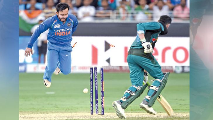 Pakistani batsman Shoaib Malik is run out for 43 as India's Kedar Jhadav looks on during the Asia Cup match played at Dubai International Cricket Stadium on Wednesday. – AFP
