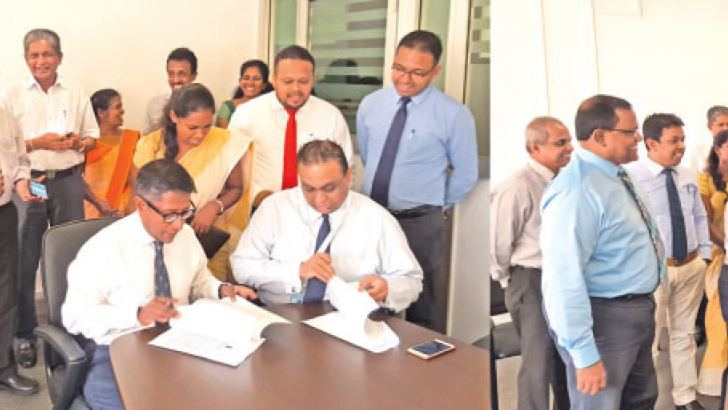 Prof. Asitha De Silva, Chairman of National Medicines Regulatory Authority (NMRA) and Thareendra Kalpage, Chief Operating Officer of Epic Lanka Technologies, signing the official agreement. Key members from NMRA including Dr. Kamal Jayasinghe, Chief Executive Officer / Director General (standing in left), National Medicines Quality Assurance Laboratory, Information and Communication Technology Agency of Sri Lanka (ICTA) and Epic Lanka Technologies at the event
