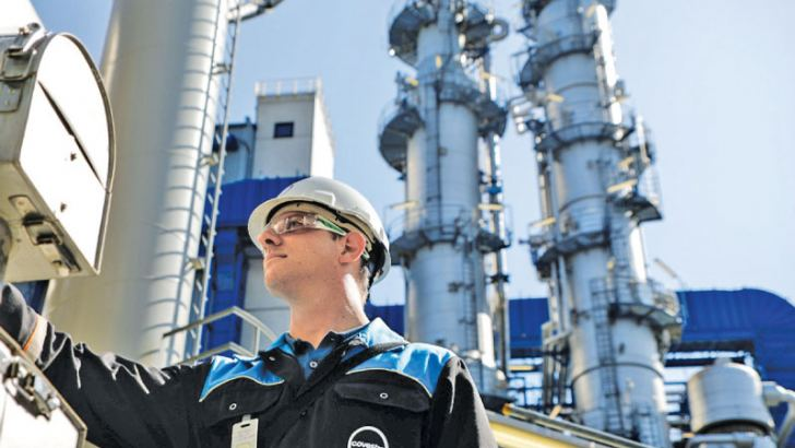 An employee inspects a hot oil pump at a Covestro chemical park in Dormagen, Germany. Photo/Agencies