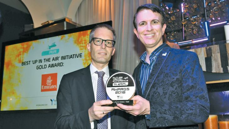 """Matthias Schmid, Emirates' Senior Vice President for North America receives the gold award by Future Travel Experience (FTE) in the """"Up in the Air"""" category by Joe Leader, CEO, Airline Passenger Experience Association (APEX) and CEO, International Flight Services Association (IFSA)."""