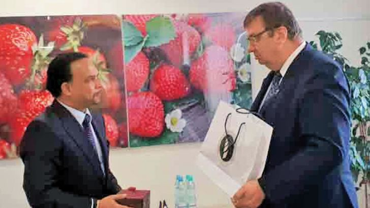 Minister Navin Dissanayake with an official in Poland.