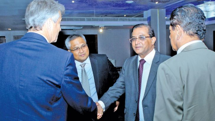 Udaya Seneviratne, Secretary to the President, Jorn Sorenson, Country Director with UNDP Sri Lanka and Carl Cruz, Chairman, Unilever Sri Lanka at the Fourm at Hilton Colombo yesterday. Picture by Saliya Rupaisnghe