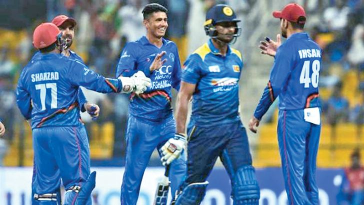 Afghanistan players celebrate the fall of another Sri Lanka wicket in the Asia Cup match played at Abu Dhabi.