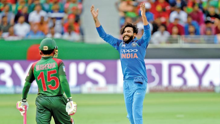 Indian spinner Ravindra Jadeja celebrates the wicket of Bangladesh batsman Mohammad Mithun for 9 in the Asia Cup Super Four match played at Dubai International Cricket Stadium on Friday. – AFP
