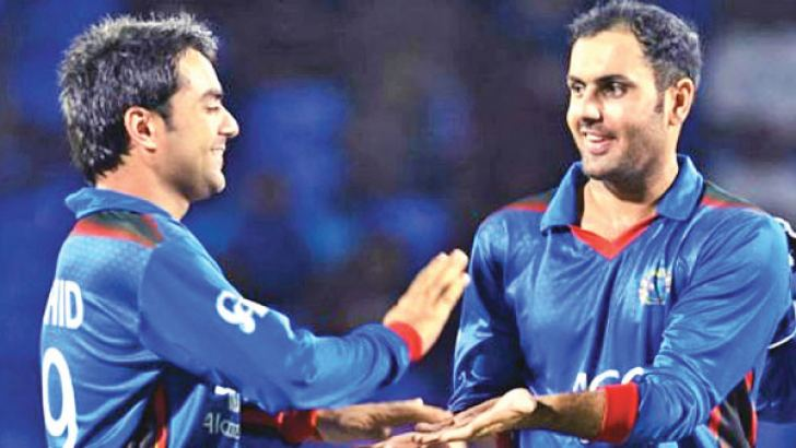 Two members of Afghanistan's spin trio Rashid Khan and Mohammad Nabi.