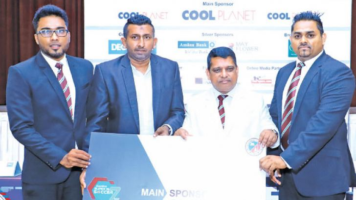 Main Sponsor of theTournament Cool Planet Pvt Ltd Head of Retail Imran Iqbal handing over the sponsorship to the Principal Trizviiy Marikkar at the press conference.  President of the PPA Shameek Samsudeen and Project Chairman Afzar Arjam  were also present.  Picture  by RUZAIK FAROOK