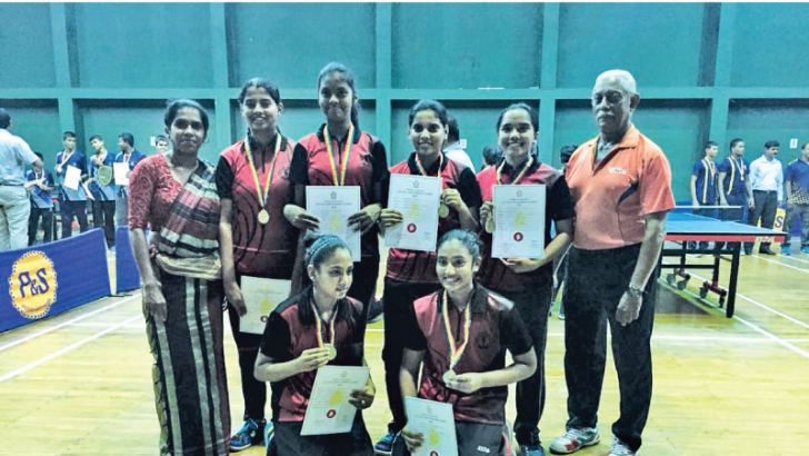 The champion Ladies College team Zeenath Hassim, Shalomie Rajkumar, Manesha Siriwardena, Ayla Chitty,   Jithara Warnakulasuriya, Anoushka De Silva (captain), Anusha Ranasinghe (Teacher in-Charge) and Former National Coach N.H. Perera with the champion award. Picture by Ruzaik Farook