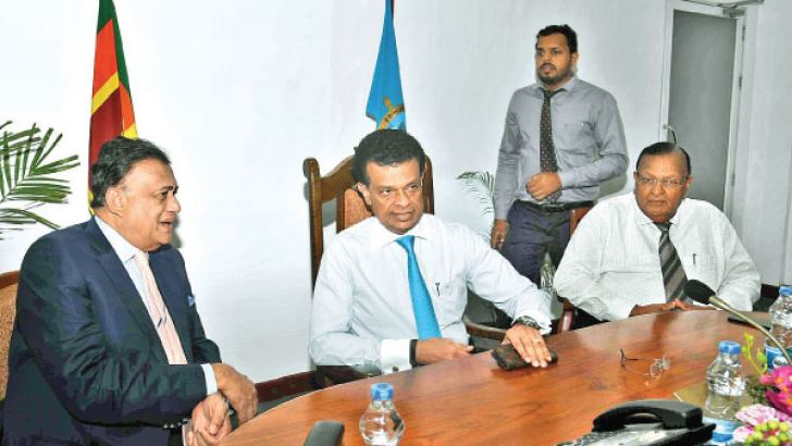 Governor of Eastern Province  Rohitha Bogollagama, Chairman of Sri Lanka Ports Authority (SLPA)  Dr Parakrama Dissanayake and Vice Chairman SLPA, P.G.Dasanayake at discussions