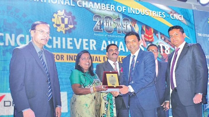 Eksath Wijeratne, Group General Manager of Browns Hotels & Resorts receiving the Merit Award in the National Level Service Sector, Extra Large Category