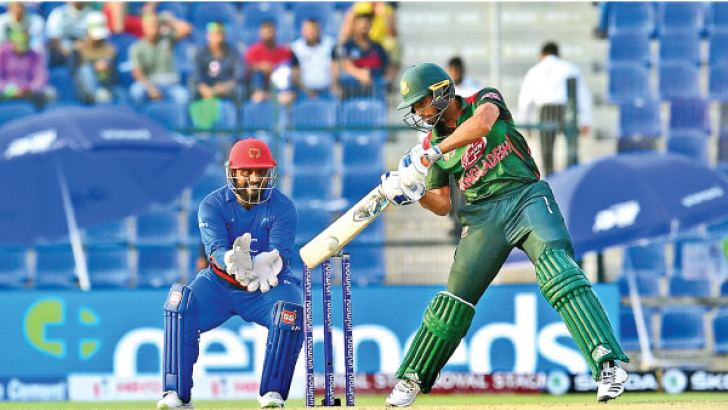 Bangladesh batsman Mahmudullah Riyadh plays a shot during the one day international (ODI) Asia Cup cricket match between Afghanistan and Bangladesh at The Sheikh Zayed Stadium in Abu Dhabi on September 23,.  AFP