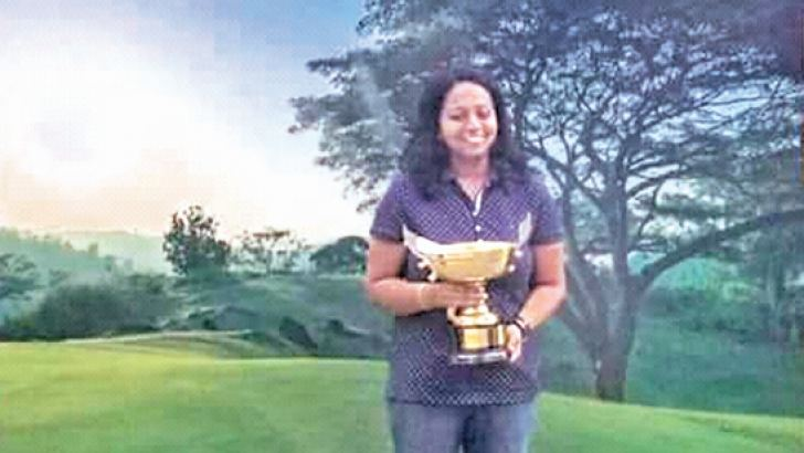Ahalya Rajan with the winner's trophy.