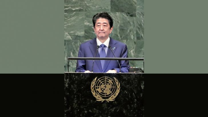 Japanese Prime Minister Shinzo Abe addresses the 73rd session of the United Nations General Assembly on Tuesday. - AFP