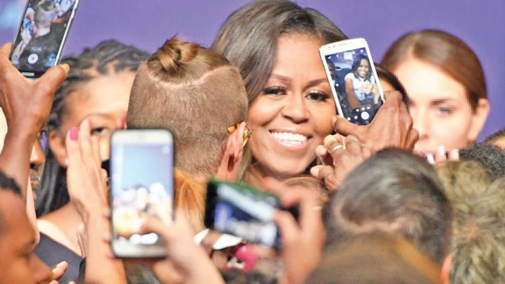 Former First Lady Michelle Obama greets supporters after speaking at a rally for When We All Vote's National Week of Action at Chaparral High School in Las Vegas, Nevada last Sunday.