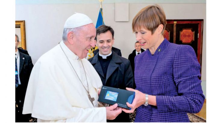 Pope Francis being presented with his own digital ID card by the Estonian President Kersti Kaljulaid during the Pope's visit to Tallinn on Tuesday. - AFP