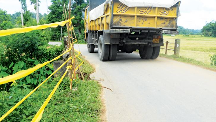 Yellow ribbons put up at the culvert to prevent road accidents..