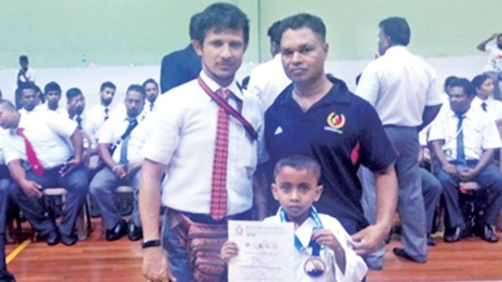Chanidu Kalpesh Herath is seen here with his coach Sensei Sugath Dharmasiri Premakumara