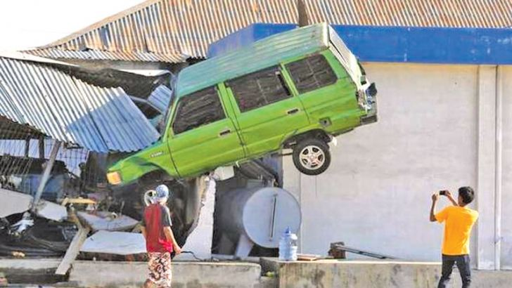 A vehicle stuck in a building in Palu, Indonesia, after the tsunami.