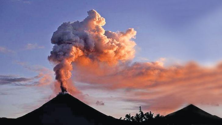 Mount Soputan spewing ash into the air