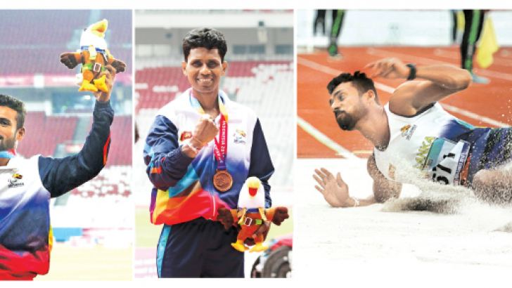Charitha Buddhika showing his gold medal-Lal Pushpakumara won the bronze medal in men's high jump-Charitha Buddhika's winning jump in the men's T42-44/61/63 long jump event. Pictures by Prince Gunasekara