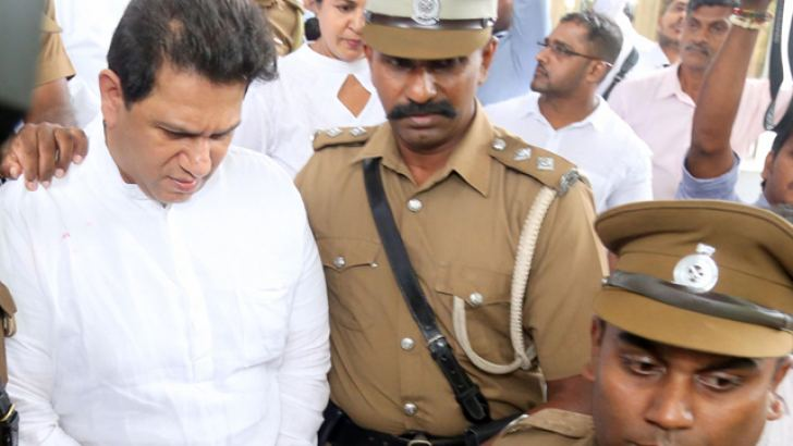 Duminda Silva being escorted by Prisons officials after the verdict. Picture by Nirosh Batepola