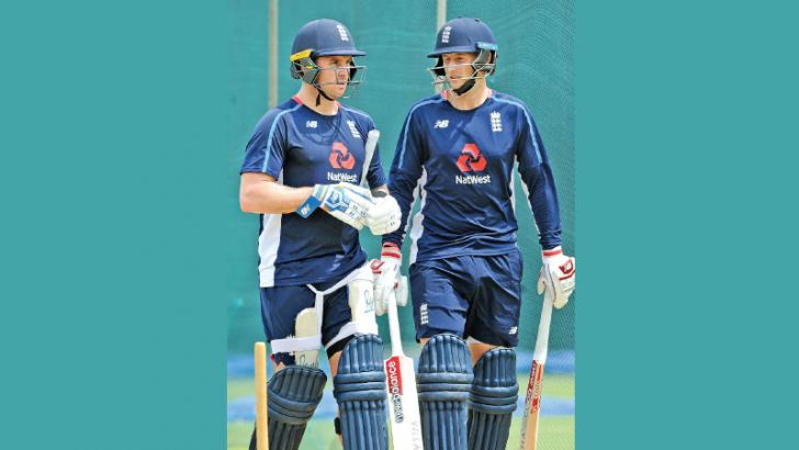 England cricketers Jason Roy and Joe Root walk after a practice session at the Rangiri Dambulla Stadium ahead of the second ODI against Sri Lanka on Saturday. – AFP