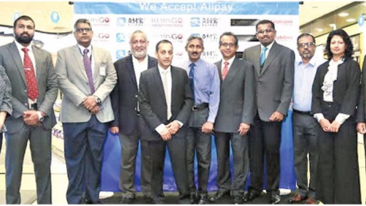 Officials of Flemingo Duty Free, Cargills Bank and Supreme Paysez at the launch