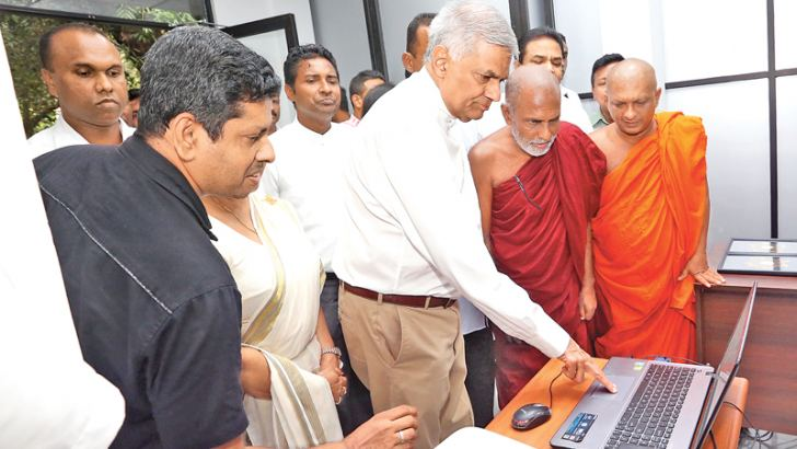 Prime Minister Ranil Wickremesinghe launches the website of the the Central Cultural Fund project office. Picture courtesy Prime Minister's Media Unit