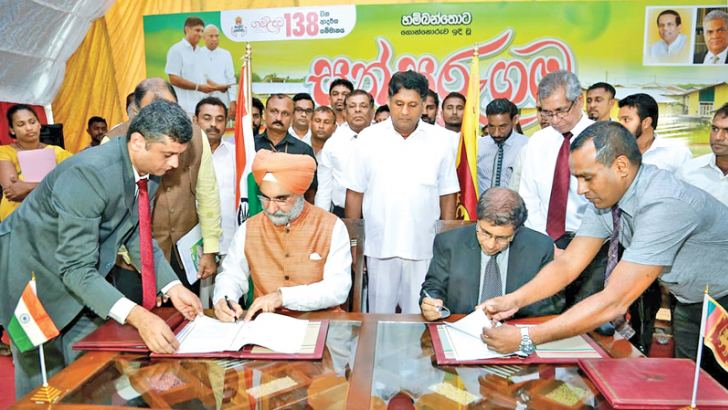 Indian High Commissioner Taranjit Singh Sandhu and Housing and Construction Ministry Secretary Bernard Vasantha sign the MoUs in the presence of Housing and Construction Minister Sajith Premadasa.