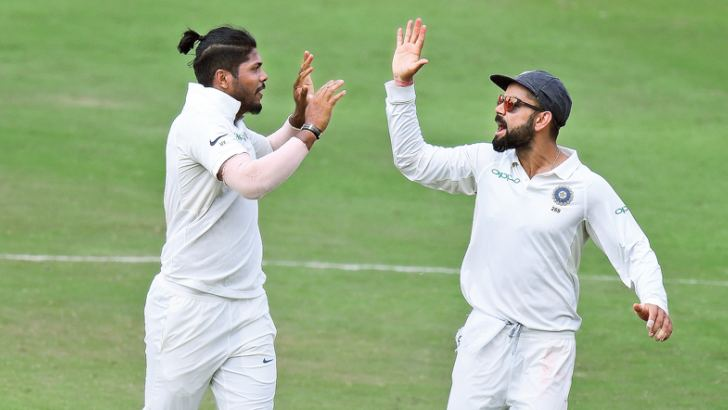 Indian captain Virat Kohli (R) and bowler Umesh Yadav celebrates the dismissal of West Indian cricketer Roston Chase (L) during the third day's play of the second Test cricket played at the Rajiv Gandhi International Cricket Stadium in Hyderabad on Sunday.  AFP
