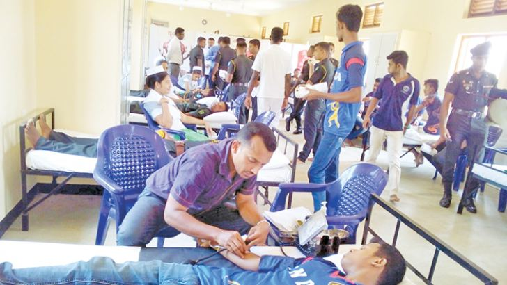 Volunteers donate blood.