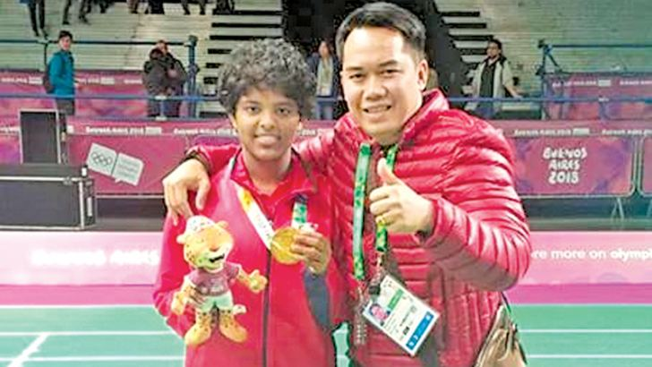 Hasini Ambalangodage with her Indonesian coach Tony Wahyudi.