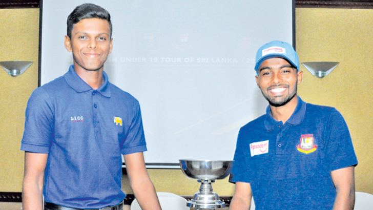 The Captain of the Bangladesh under 19 team, Tawhid Hridoy and Sri Lanka under 19 captain Nipun Dananjaya with the trophy that will be awarded to the winners of the two-match under 19 test series. Picture by Sudam Gunasinghe