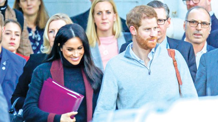Prince Harry and Meghan are seein leaving the Sydney airport on arrival in Australia for the Royal tour. The Duchess had sparked speculation she was pregnant after arriving in Australia carrying two purple folders.