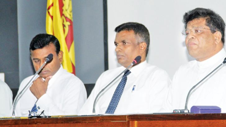 Deputy Minister Ajith Mannapperuma  and other officials at yesterday's media briefing. Picture by Roshan Pitipana