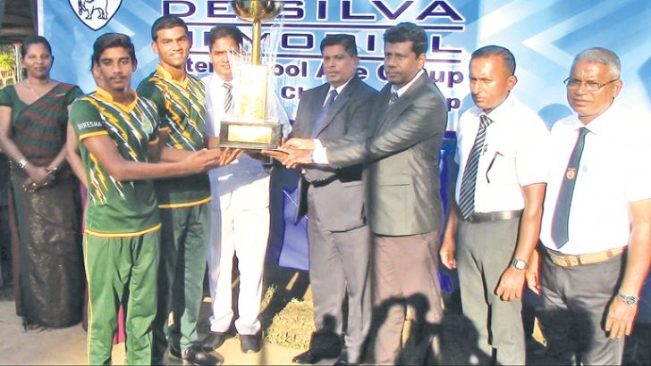 Captain of St. Sebastian's College Lasith Saranga and Dharmashoka Vidyalaya captain S.K.S. Biyanka receiving the champion trophies from the chief guest Ambalangoda ASP P. T. Sisira, Guest of Honour Chaminda Thilakaratne and the Principal of Dharmashoka Vidyalaya Hasitha Kesara Wettamuni.