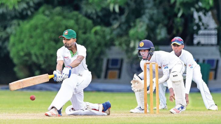 Bangladesh captain Towhid Hridoy sweep for runs in his unbeaten innings of  54 on the first day of the first under 19 cricket test against Sri Lanka at  the NCC grounds yesterday.