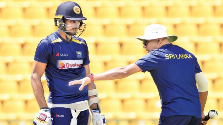 Sri Lanka allrounder Dasun Shanaka gets a few tips on batting from head coach Chandika Hathurusingha at the Pallekele International Stadium ahead of the third ODI against England. - AFP