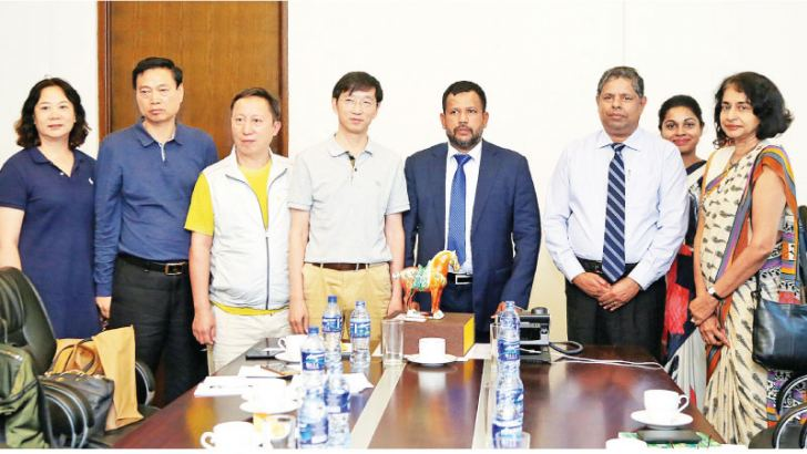 Minister of Industry and Commerce, Rishad Bathiudeen, Chairman of China National Agriculture Wholesale Market Association, Zengjun Ma with his delegation and Sri Lanka DG Commerce, Sonali Wijeratne after the successful meeting at Ministry of Industry and Commerce