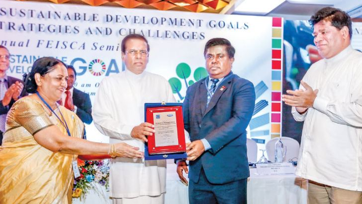 President Maithripala Sirisena who was Chief Guest at the Regional Conference of the Federation of Engineering Institutions of South and Central Asia being presented with a token of appreciation by Sri Lanka Engineers Association Chairman Prof. Niranjani Rathnayake. Picture by Udesh Gunaratne