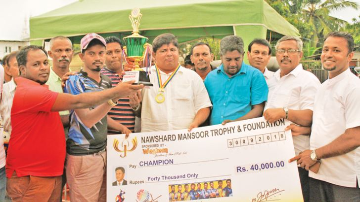 Panadura United Sports Club captain receives the Nawshard Mansoor trophy from the chief guest. Picture by: M.K.M.Azwer – Moratuwa central special Corr.