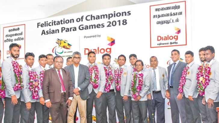 The champion para athletes with Kamal Padmasiri, Secretary, Ministry of Sports and Provincial Councils and Local Government, Hon. Faiser Mustapha MP, Minister of Sports and Provincial Councils and Local Government and Harsha Samaranayake, General Manager, Brand and Media, Dialog Axiata PLC.