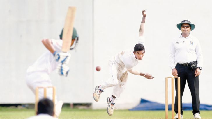 Fast bowler Chamindu Wijesinghe who took four wickets for 68 runs for Sri Lanka on the second day of the first under 19 cricket test against Pakistan at the NCC grounds yesterday in action.