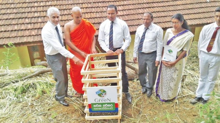Officials of LOLC and Liyangahawela Maha Vidyalaya in Bandarawela, participates at the tree planting program.