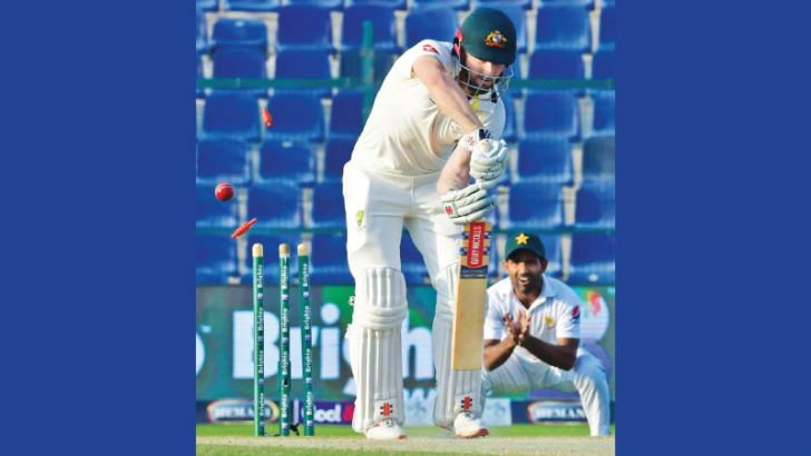 Australian cricketer Mitchell Marsh is been dismissed by Pakistan crickters Mir Hamza during day three of the second Test cricket match in the series between Australia and Pakistan at the Abu Dhabi Cricket Stadium in Abu Dhabi on October 18. AFP